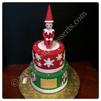 Elf On A Shelf Cake Vanilla cake covered and decorated with fondant.