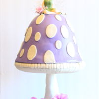 Fairy Toadstool Cake I made this cake for my daughters birthday. She wanted a fairy cake so I decided to put the little fairy on a toadstool. The sugar flowers...