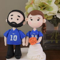 Football Fan Cake Topper Bride and groom cake toppers, sporting football jerseys!