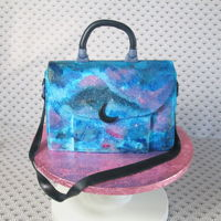Galaxy Handbag Cake Hi All! This is my version of a Galaxy Cake, I thought that a Galaxy handbag would be really cool, and I rally hope you like it as well....