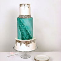 Geode Wedding Cake Edible silver leaf was used for the top and bottom tiers, I made teal rock candy for the center of the cake.