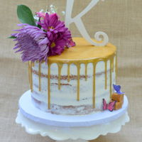 Gold Drip Semi Naked Cake Vanilla Cake with Italian meringue buttercream, dripped with white chocolate ganache