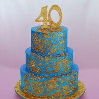 Gold Mendhi 40Th Biirthday Cake Chocolate mud cake filled with chocolate ganache, iced with butter cream and airbrushed turquoise, and decorated with gold edible lace and...