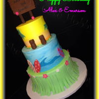 Hawaiian Luau Birthday One cake - two birthdays. Iced in buttercream with all fondant decorations. Original design - drawn by one of the 10 year old birthday...