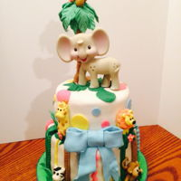 Jungle Baby Shower This cake was made for a coworker's baby shower. All fondant details other than the elephant toy on top which was added as a special...
