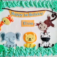 Jungle Themed Birthday Cake Banana cake with SMBC and fondant animals