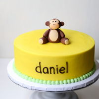 Monkey Birthday Cake monkey birthday cake - banana cream birthday cake with handmade fondant monkey topper