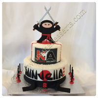 Ninja Girl Cake Vanilla cake with buttercream filling and frosting and fondant decorations.