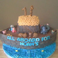 Noah's First Bday Cake fondant covered.. used football pan for mold. animals are fondant