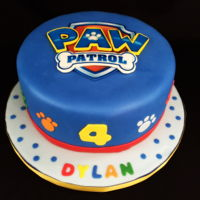 Paw Patrol Paw Patrol logo is an edible image which is placed on a gumpaste template. The shield, letters and bone are gumpaste. I then placed the...
