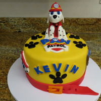 Paw Patrol   Vanilla cake with white chocolate ganache and strawberry filling covered in fondant with a fondant figure and acccents
