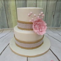 Peony Wedding Cake A small wedding cake with a burlap ribbon and a soft-pink peony