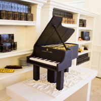 Piano Cake   Piano cake with wooden legs and lid. All decorations is fondant. Cake was 1m x 60cm and VERY heavy :) :)
