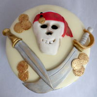Pirate Skull And Swords Cake Pirate skull and swords birthday cake