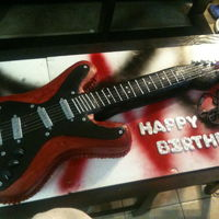 Rock-N-Roll Birthday I made the stencil for this guitar out of cardboard. laid down cake and cut it out, Iced it with red buttercream and detailed with...
