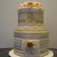 Romance Fondant covered cake with wafer paper flowers and cake lace. Birds are done with a stamp.