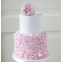 Romantic Pink Ruffles Romantic pink ruffles wedding cake with edible lace.