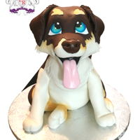 Sculpted Puppy Cake Husky Collie sculpted dog/ puppy cake out of carrot cake with cream cheese frosting. covered in marshmallow fondant.