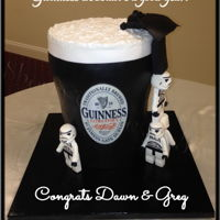 Star Wars Guinness Groom's Cake Lego Storm Troopers Chocolate cake paneled in thin fondant, topped with buttercream and with hand made / hand painted storm troopers and Darth Vador. Recreated...
