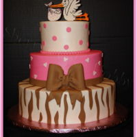 Stork Baby Shower Cake Iced in buttercream with all fondant decorations...topper hand made / painted to match invitations. Dots, hearts and zebra - fondant bow.