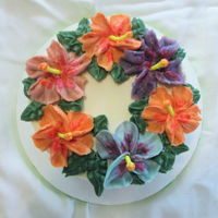 Top View Of Hibiscus Cake Buttercream flowers with fondant stamens