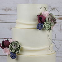 Wedding Cake Elegant Wedding cake with gum paste succulents.