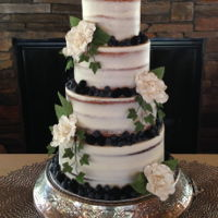 Wedding Cake For Sara I made this cake for a young lady who wanted a four tier semi-naked cake with blueberries and blackberries and flowers here and there. She...