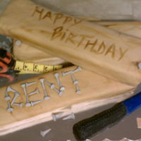 Woodworking Cake fondant covered cake. rkt wrapped in modeling chocolate for tape measure and hammer