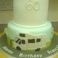60Th Birthday 2 tiered cake based on favourite pastimes. Skiing and festivals