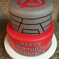 Avengers Birthday Cake   Gray and red fondant covered tiers with simple Avengers logo on top.