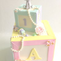 Baby Shower Letter Blocks Love this design! It incorporates all the pastel colors for a baby shower with a touch of vintage. Perfect for a tea party baby shower!