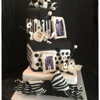 Black And White Stacked Gift Boxes 3 Black and white stacked gift boxes with edible pictures and frames, roses, gumpaste embellishments, etc....