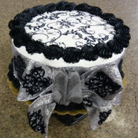 Black & Silver Double layer white cakeWhite and Black buttercream icingEdible imageBlack and Silver ribbon/bow