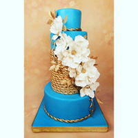 Blue And Gold Nutical Theme Wedding Cake A wedding cake inspired by the brides wedding dress color and wedding theme
