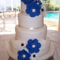 Blue Flowers On Wedding Cake   Customer wanted large blue flowers that matched the Maid of Honor's dress.