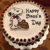Boss's Day Cake Three layer chocolate cake with kahlua mousse filling, frosted and decorated with buttercream. Snoopy is a buttercream frozen transfer.
