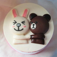 Bunny And Bear Cake With Matching Macarons   Shower cake - vanilla cake with strawberry SMBC. Bunny macarons have an Earl Grey filling and the bears are chocolate.