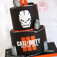Call Of Duty Black Ops Iii Cake Call of Duty cake for an 11 year old. The Call of Duty letters and skull were cut from the fondant, the Black Ops letters were cut from a...