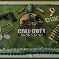Call Of Duty Black Ops11 Cake Full Sheet cake, buttercream frosting airbrushed camo. Everything edible except for the picture.
