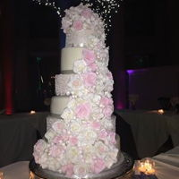 Cascading Roses This is the wedding cake I made for my daughter this past weekend