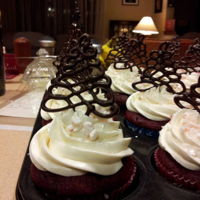 Christmas Cupcakes  Red velvet cupcakes with boiled frosting flavored with peppermint extract, sprinkled with crushed candy cane and topped with dark chocolate...
