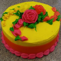 Color Shift Pink To Yellow Double layer Chocolate CakeButtercream icingColor shift from Pink to YellowRoses