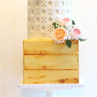 Country Chic A country chic cake. The bottom tier a wooden crate with a double tier on top inspired by a broderie anglaise shirt. The top tier has a...