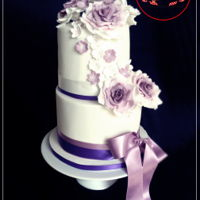 Delicate White&purple Wedding Cake   Two tiered wedding cake was part of a dessert table I did last Sunday. All handmade and edible. Hope you like it!