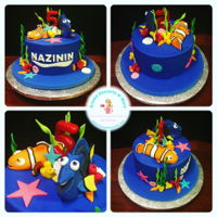 Dory And Nemo Cake Coffee Cake with Chocolate Fudge filling, covered and decorated with fondant.