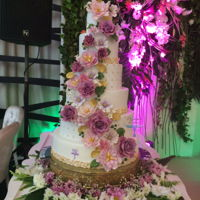 Floral Wedding Cake A 6 tiers wedding cake with a lot of gum paste flowers :peonies ,roses, cosmos and more...