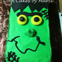 Frankenstein Baked a 10x10 cake and cut it in half to make 2 different cakes for a cake walk for the fall festival. Green buttercream frosting with...