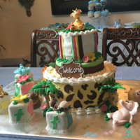 Giraffe Baby Shower Baby Boy Shower with Jungle animals and a Giraffe to top it all of. RCT baby blocks covered in fondant with baby animals and flowers on top...