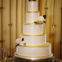Gold Trim Wedding Cake A white and gold themed wedding cake with hand piped dots. My dot texture tool didn't get delivered in time to use it, so i had to...