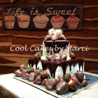Grooms Cake Chocolate cake 10x10 base and 6x6 top. Whip cream frosting covered in chocolate ganache. Chocolate covered strawberries surrounding with a...